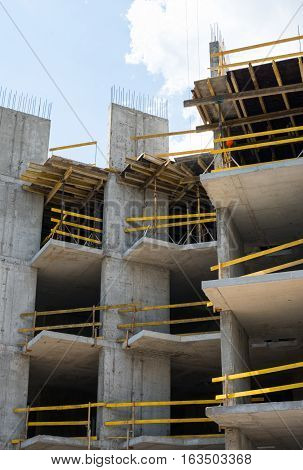 Grey concrete framework of the future building in the construction site