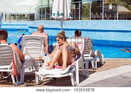 NESSEBAR BULGARIA - SEP 01: People resting near the pool in hotel Marvel in Nessebar Bulgaria at September 01 2016