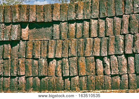 a large pile of old moldy bricks which were hand made