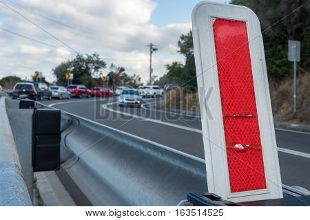 Red roadside safety reflector, especially important for hilly and curved traffic - day or night.
