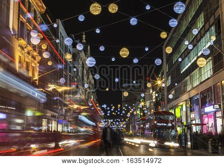 LONDON UK - DECEMBER 9TH 2015: A view of a busy Oxford Street during the lead up to Christmas in London on 9th December 2015.