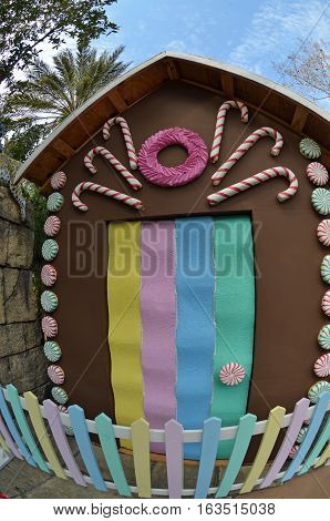 Life size ginger bread house with candy cane and gum drop decorations