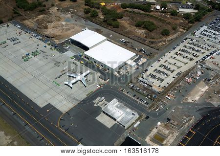HONOLULU - APRIL 20: Aerial view of planes helicopters and hangers at the Honolulu International Airport HNL on Oahu Hawaii. April 20 2016.
