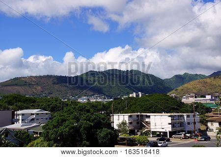 Kapahulu town in Honolulu with homes condos and mountains of Tantalus and St. Louis Heights on a clear day on Oahu Hawaii