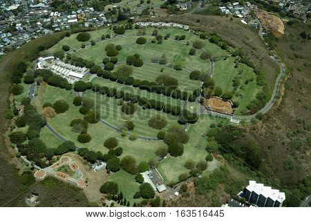 Aerial view of Punchbowl Cemetery or the National Memorial Cemetery of the Pacific with parts under construction which is visited by millions of tourist and island locals every year on the tropical island of Oahu in Honolulu Hawaii USA. April 2016