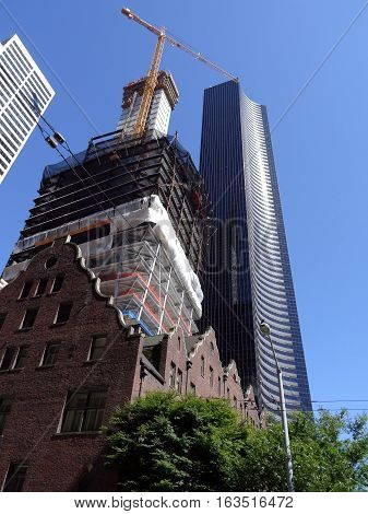 The Rainier Club building under construction and Columbia Center in Seattle Washington on a nice day June 2016.