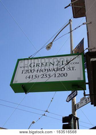 SAN FRANCISCO - APRIL 30: Looking up at Green 215 sign on Howard and 8th a medical marijuana pot shop store taken on April 30 2011 in San Francisco.