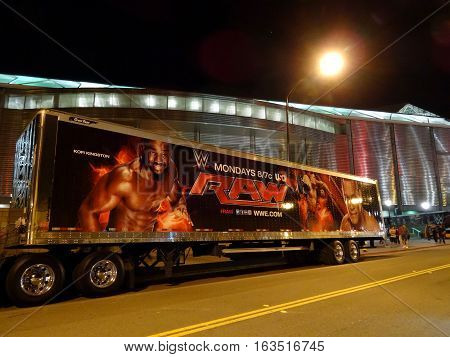 SAN JOSE - MARCH 30: WWE Raw Truck with John Cena and Kofi Kingston image on side outside arena at night after Monday Night Raw broadcast at the SAP Center in San Jose California on March 30 2015.