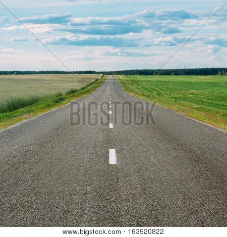 Empty motorway highway and green field in rural area