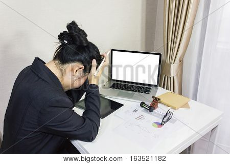 Business women got pain or headache work hard and computer on work table