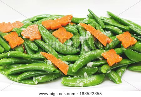 Fried Pea And Carot With Garlic On White, Vegetarion Healthy Food