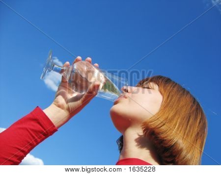Girl Drinking Water From Clean Glass