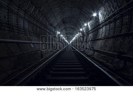 Underground tunnel. Railway in a subway tunnel