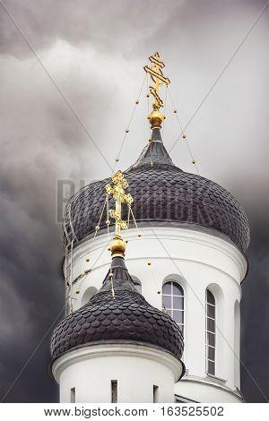 Orthodox church domes in a dark sky in Kaunas Lithuania