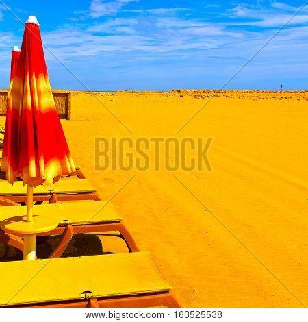 Beach Umbrella and Sun Bed in the Low Season