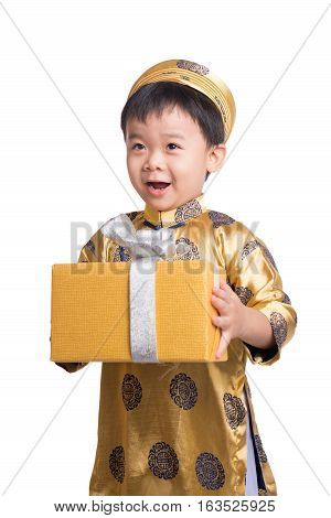 Happy chinese new year. Happy Tet Holiday. Smiling asian little boy holding gold gift.
