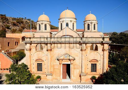 Elevated view of the front of the Agia Triada monastery and domes Agia Triada Crete Greece Europe.