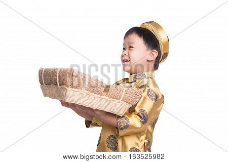 A vietnamese boy in Ao Dai traditional dress holding new year hamper isolated on white