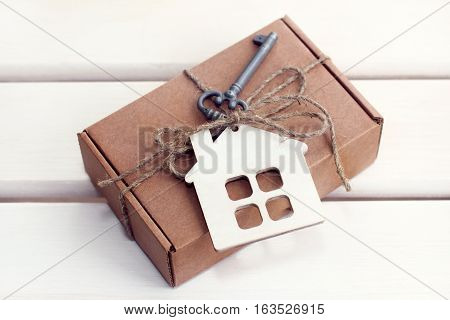 box bandaged festively symbol key and house on bright background / individual special gift with a hint