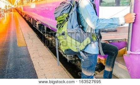 Traveler Holding And Stepping Up To A Train With Backpack For Journey Travel At Train Station.