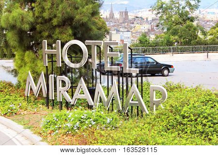 BARCELONA, SPAIN - OCTOBER 08, 2013: Signboard Miramar Hotel and view of Barcelona in Barcelona, Spain.This Barcelona property is next to the Montjuic Botanical Gardens and within one kilometer of Sant Pau del Camp