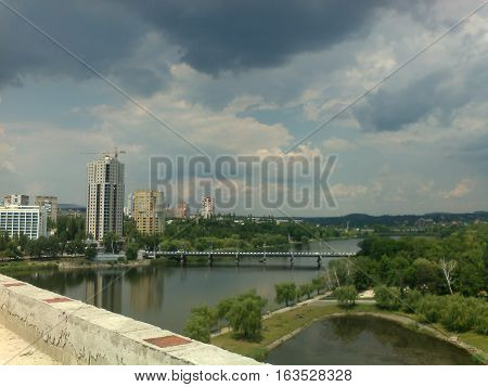 Landscape of the river Kalmius in Donetsk, a town in the background