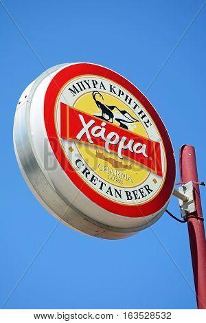 KALYVES, CRETE - SEPTEMBER 16, 2016 - Charma Cretan beer sign against a blue sky Kalyves Crete Greece Europe, September 16, 2016.
