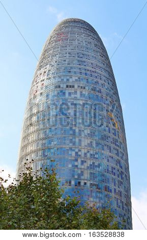 BARCELONA, SPAIN - OCTOBER 08, 2013: Torre Agbar in Technological District in Barcelona, Spain. This 38-storey tower was designed by the famous architect Jean Nouvel