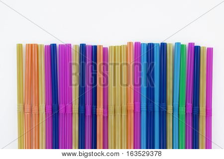 Colorful drinking plastic straws on the white background
