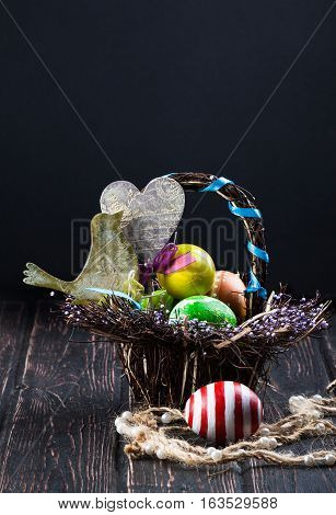 Easter eggs on wood desk. Greeting card. Nature background