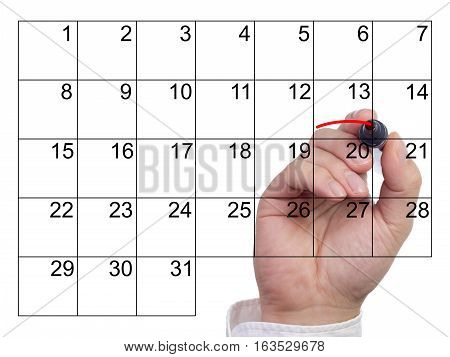 Hand underlines an event in a calendar with a red pen