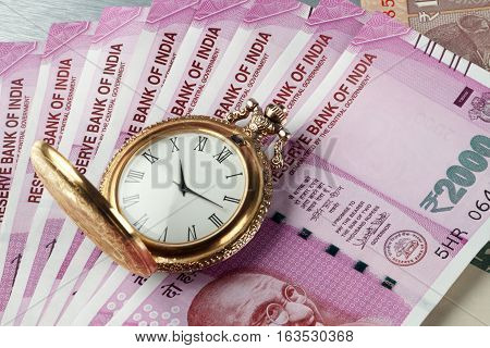 New Indian Rupees Currency with antique time watch