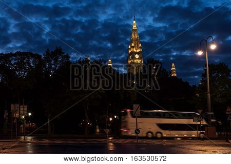 View on famous city hall, rathaus, at night, bus on the street, vienna, austria