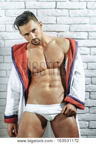 Handsome Muscular Macho In Bathrobe