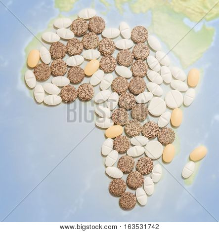 Pills in a shape of a Africa