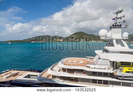 A massive luxury yacht anchored in the Caribbean