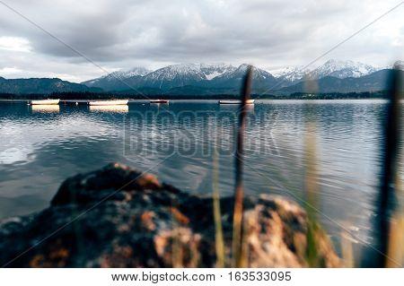 lake cabin boathouse fishing hopfensee bavaria mountains