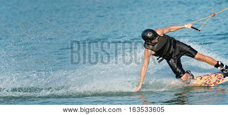 Wakeboarder Making A Water Curtain