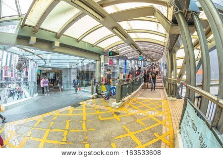 Hong Kong, China - December 4, 2016: the beginning of Central-Mid-levels escalator on Queen's Road Central, a system of escalators and walkways connecting Central to Western District in Hong Kong.