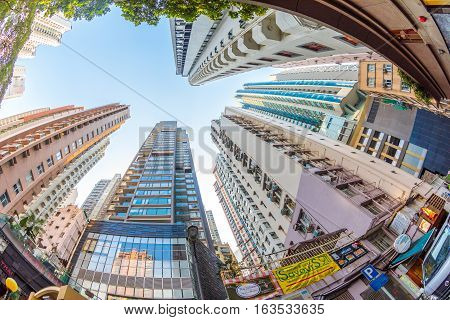 Hong Kong, China - December 4, 2016: fish eye lens view and perspective to high rise buildings in the popular and historic district of Soho in Hong Kong island.