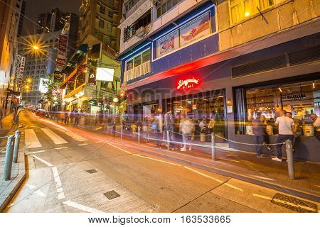 Hong Kong, China - December 10, 2016: The Linguini Fini restaurant in Elgin Street by night, popular road Soho district in Central Hong Kong, famous for bars, restaurants, clubs and nightlife.