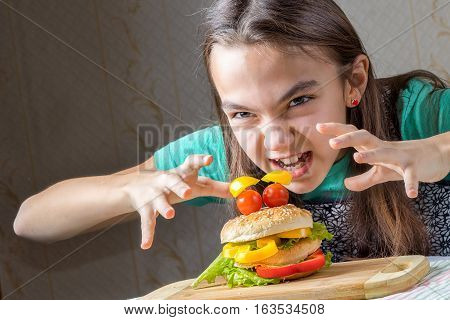 girl eagerly pounced on a hamburger holding out her arms to him with a crooked fingers