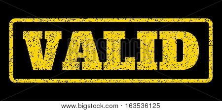 Yellow rubber seal stamp with Valid text. Vector message inside rounded rectangular frame. Grunge design and unclean texture for watermark labels. Horisontal emblem on a blue background.