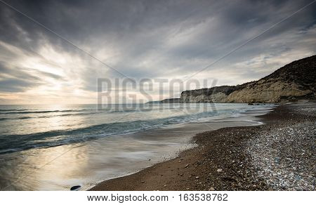 Beautiful seascape late in the evening with dramatic stormy sky at Episkopi area in Limassol Cyprus.