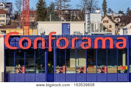 Wallisellen, Switzerland - 28 December, 2016: windows of the Conforama store, buildings of the town in the background. Conforama is Europe's second largest home furnishings retail chain with over 200 stores.