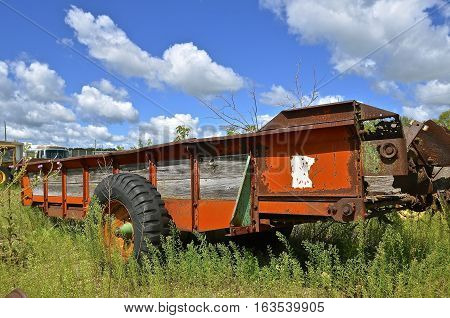 DETROIT LAKES, MINNESOTA, August 5, 2016: The old manure spreaders a product of the Minnesota State Prison system in Stillwater where inmates built farm equipment through the 20th century in a rehabilitation program.