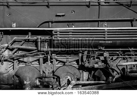 Horizontal shot of train machinery in black and white