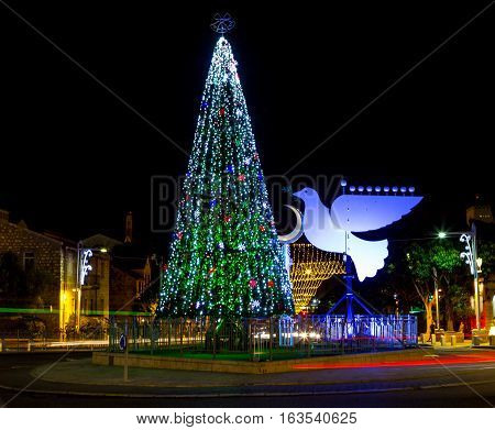 Christmas tree and Hanukkah menorah in the form of a dove in Haifa Israel
