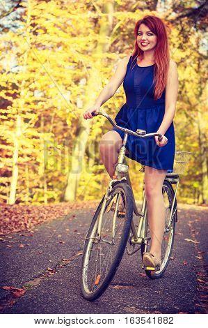 Young Ginger Hair Girl On Bike.