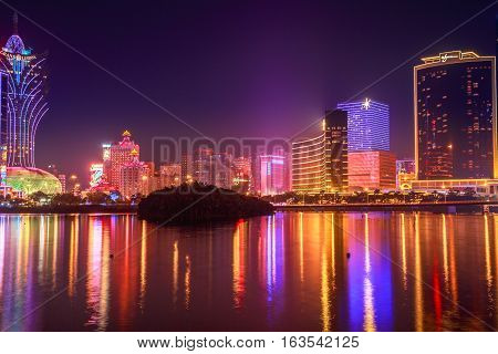 Macau, China - December 9, 2016: Cityscape with Wynn Macau, MGM Macau, Casino Lisboa and Grand Lisboa Hotel that reflected in Nam Van Lake, a man-made lake in southern end of Macao Peninsula.